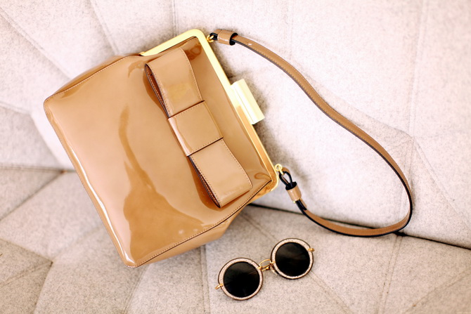 Orla Kiely bag, miu miu sunglasses